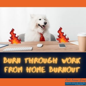 dog sitting at a desk with flames