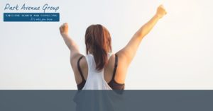 a women standing backwards with her arms up cheering