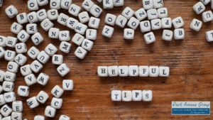 letters spread out on a table saying helpful tips