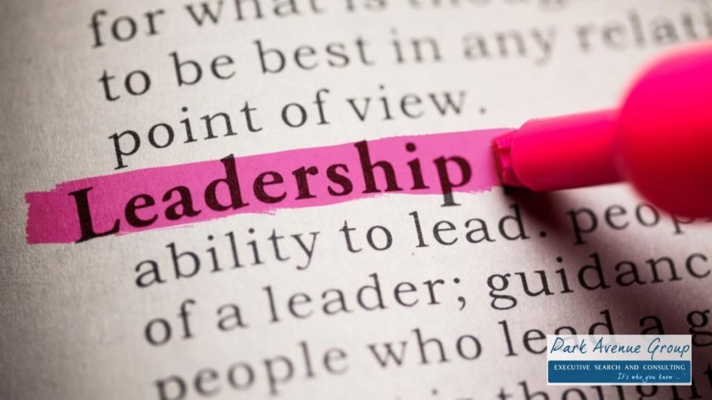 a page from a book with the word leadership in bold getting highlighted in pink
