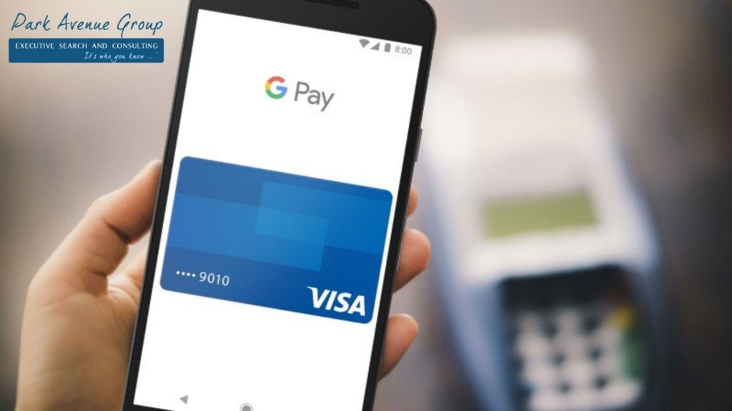 someone holding a phone that is looking at google pay